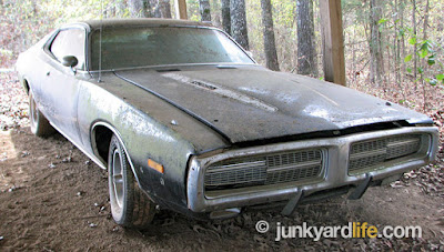 Black and white 340 equipped 1973 Dodge Charger has been customized with 1972 model hideaway headlights.