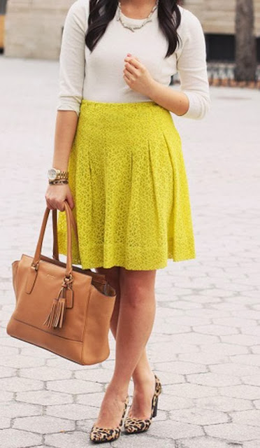 White Long Sleeveless Shirt With Yellow Skirt And Brown Bag