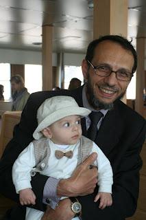 Mehmet, a vapur friend, and his son.