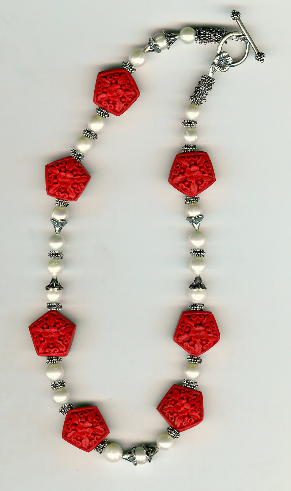 221. Carved Cinnabar, Freshwater pearls and Bali Sterling Silver