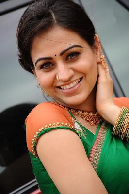 aksha in saree cute stills