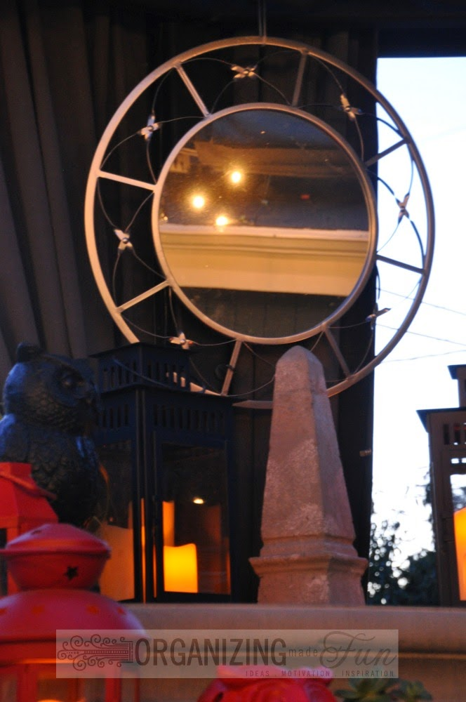 Round Mirror over outdoor fireplace :: OrganizingMadeFun.com