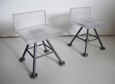 Two modern dolls' house miniature white and grey bar stools from the Kaleidoscope House.
