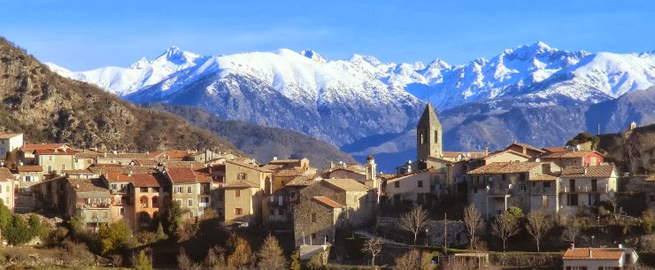 Village of Utelle with the Mercantour peaks in the background