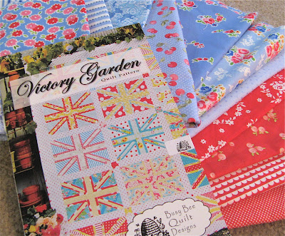 Victory Garden quilt pattern with red and blue fabric
