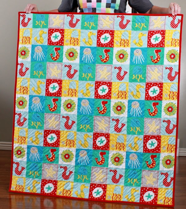 Fabric mill under the sea baby quilt free tutorial for Baby themed fabric