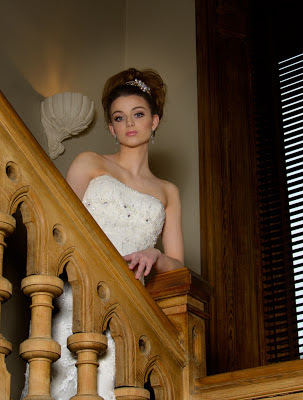 Bride standing on the stairs with wedding dress