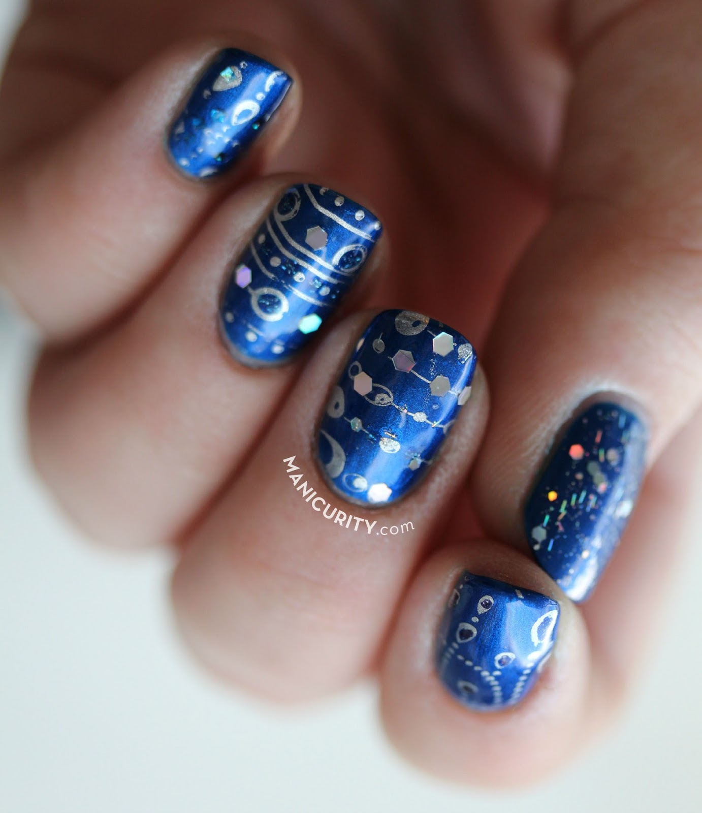 The Digit-al Dozen: Stamped Sapphire Birthstone Jewelry Nail Art | Manicurity.com @emmathea