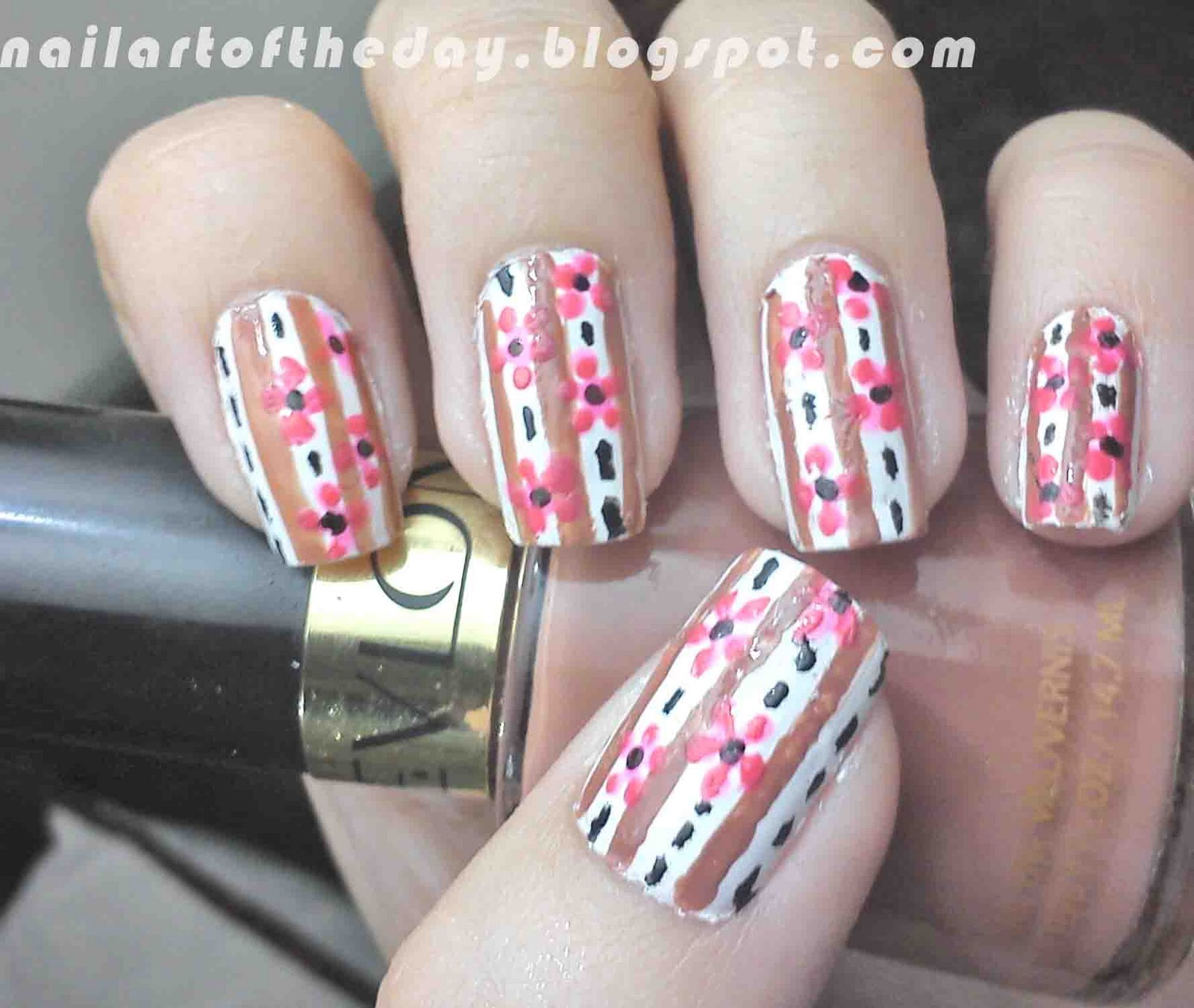 Nail art of the day nail art hanging flowers Hang up paintings without nails