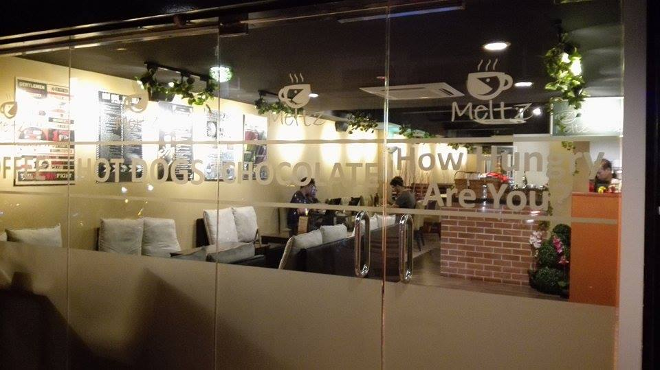 quite a nice ambiance you need to order the food from the front counter and pay first wifi password is printed in the receipt - Glass Front Cafe 2015