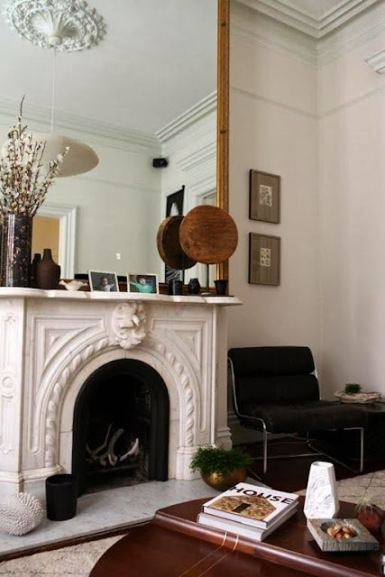 neutral living room oversized gold mirror fireplace accents neutral furniture