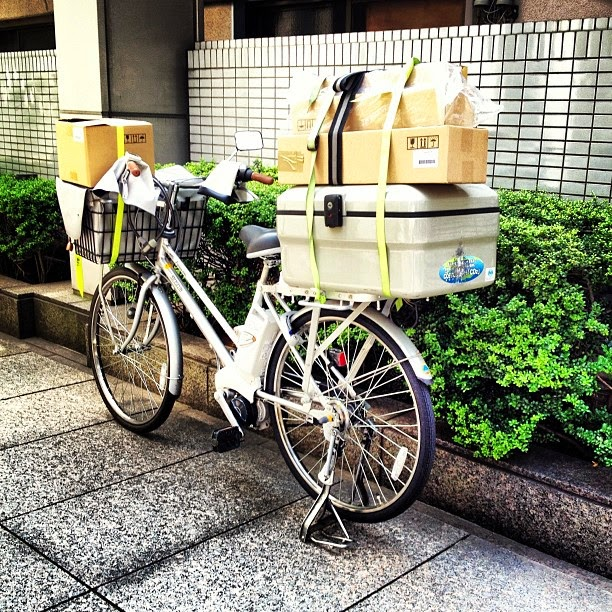 Heavily loaded delivery bicycle in Japan.
