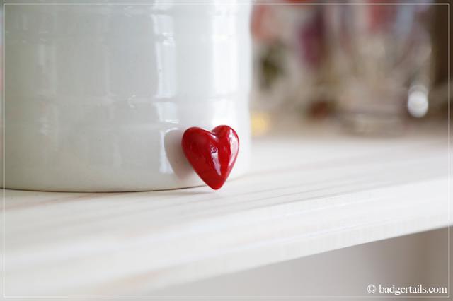 Red Glass Heart on Bookshelf