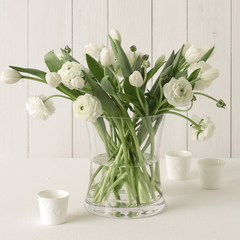 White flowers i love the combination of white tulips and white ranucles shown by the white company in a white jug for a more country look or in a beautiful vase for mightylinksfo
