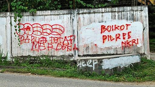 Coretan grafiti di Jayapura yang menuntut pemisahan Papua dari Indonesia