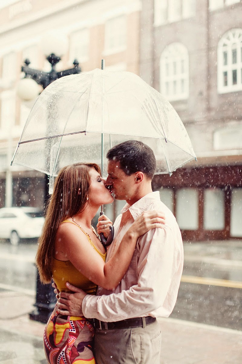 romantic couple in rain - Couple Kissing in the Rain on town