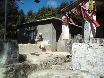 A old man praying to their local deity in the Himalayas in Kemundakhal temple