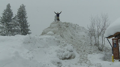 author Jason Matthews standing on huge pile of snow Truckee California