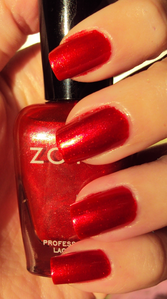 Zoya - Kamilah is a shimmery polish that is on the orange side  but    Zoya Kamilah