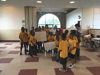 Laurel and Audrey with summer day campers at East Side Community Center