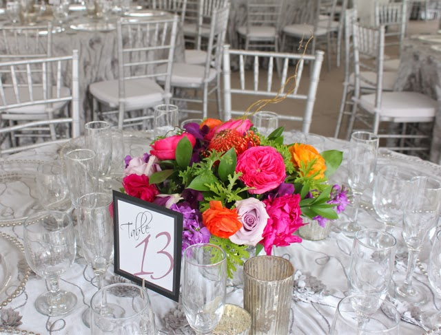 mercury glass compote centerpiece by sweet pea floral design Ann Arbor for Earhart Manor Concordia University Wedding  orange ranunculus fuchsia peony, pink garden rose, scented geranium