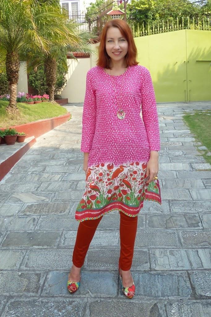 Indian Biba printed tunic worn over orange skinnies