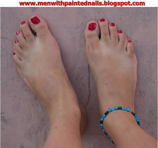 Man with red painted toes and anklet