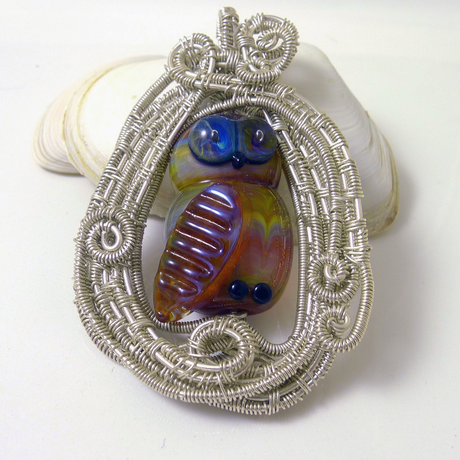https://www.etsy.com/listing/183603900/lampwork-owl-and-sterling-silver-pendant?