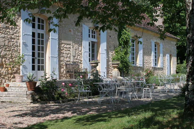 Eye for design decorating the stone home for French country courtyard
