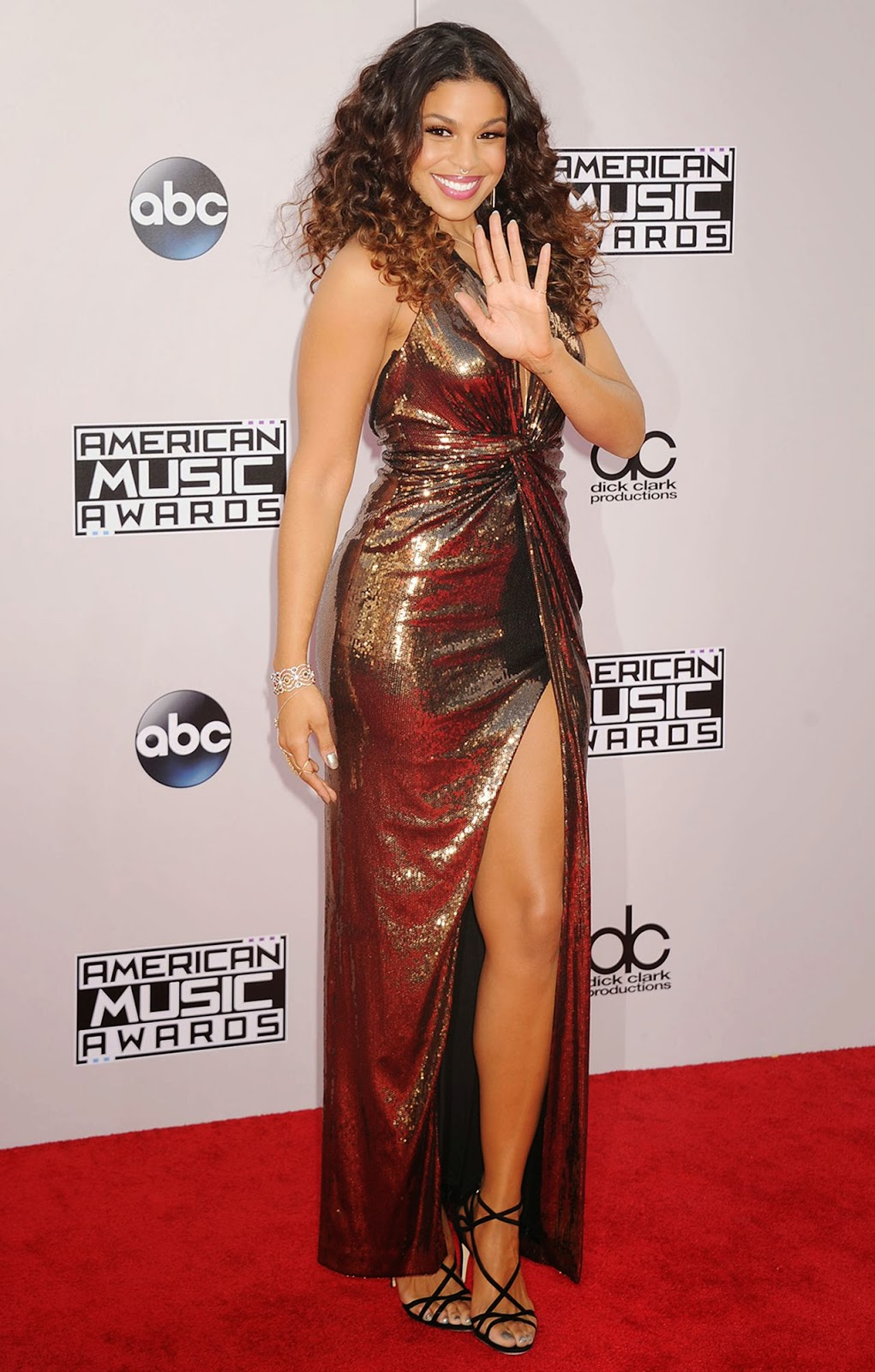 Jordin Sparks in a sequinned bronzed Halston Heritage gown at the 2014 American Music Awards