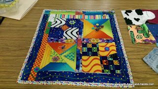 http://www.with-heart-and-hands.com/2015/08/making-fidget-quilts-for-alzheimers.html