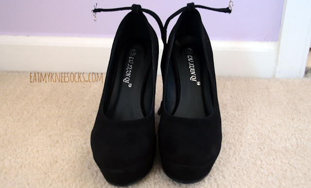 The black wedged pumps from Milanoo have a simple ankle accent and sloping heel.