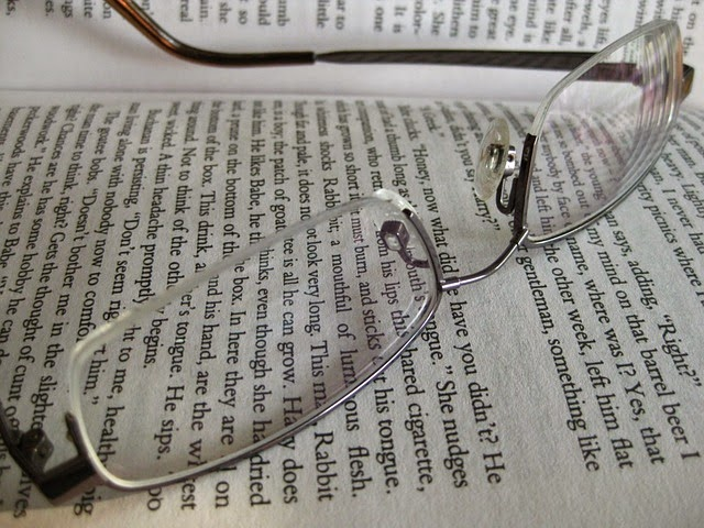 image of glasses sitting on top of a book