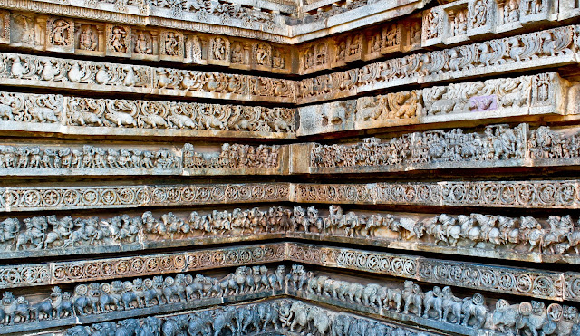 Similar to that of Belur temple, the first three rows carries Elephants, Lions and Horses