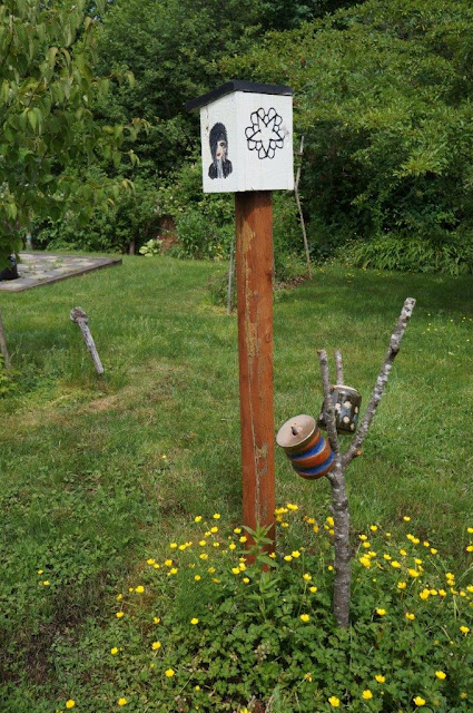 Ceramic pieces await their turn to be part of a garden totem.  BVB bird house in the garden.