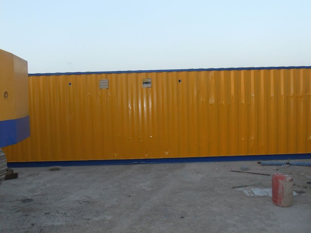 Picture of yellow trailer with construction equipment on the Kingdom Tower construction site