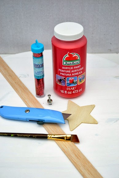 Red paint and glitter, a box cutter, some wood pieces and a paintbrush will all come together to make a christmas countdown clock