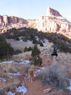 John and Scout working their way up to the Wingate Sandstone spires of Devil's Canyon