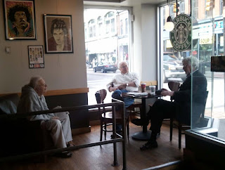 Gentlemen at Starbucks Drinking Coffee