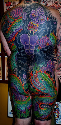 Full body tattoo of a gorilla and snake by tattoo artist Jason Kunz for Triumph Tattoo