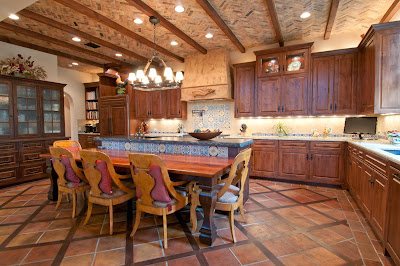 strong wood accents in the dining room area includes cabinetry, furniture, and earthly colored floor and ceiling