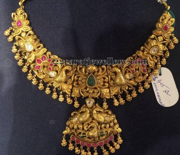 Crafted Nakshi Work 22 Carat Gold Set Jewellery Designs