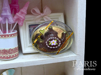 Miniature dark chocolate teapot in clear presentation box