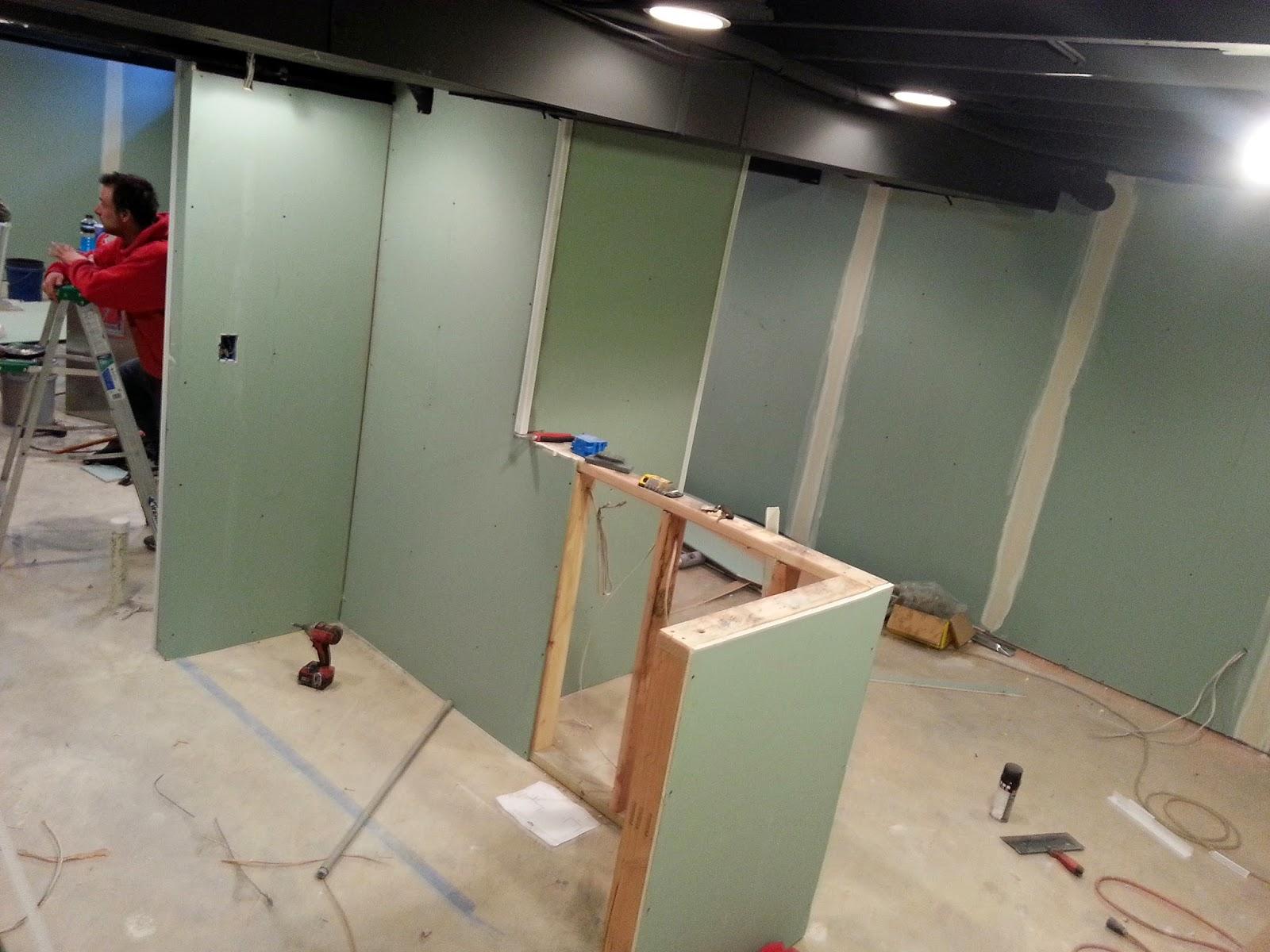 basement finishing drywall on metal and wood studs
