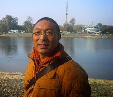 Trehor Lama in front of a lake during a visit at the Bodhi Path center in Belgrade