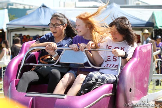 Centre: Georgia Telford, Havelock North, with L-R: Naho Inoue and Ami Yamamoto, Japanese exchange students at Havelock North High School, Havelock North, on the Sizzler, one of the sideshows run by Mahon Amusements. photograph