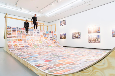 Skateboard ramp with Eric Kessels' collection of feet selfies, at NRW-Forum Düsseldorf