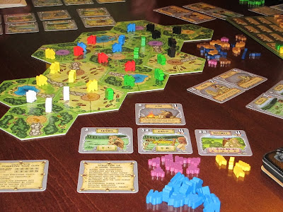Power Grid: The First Sparks - The game board, cards and clansmen
