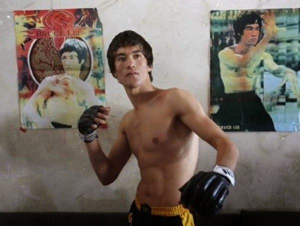 Abbas Alizada with posters of bruce lee