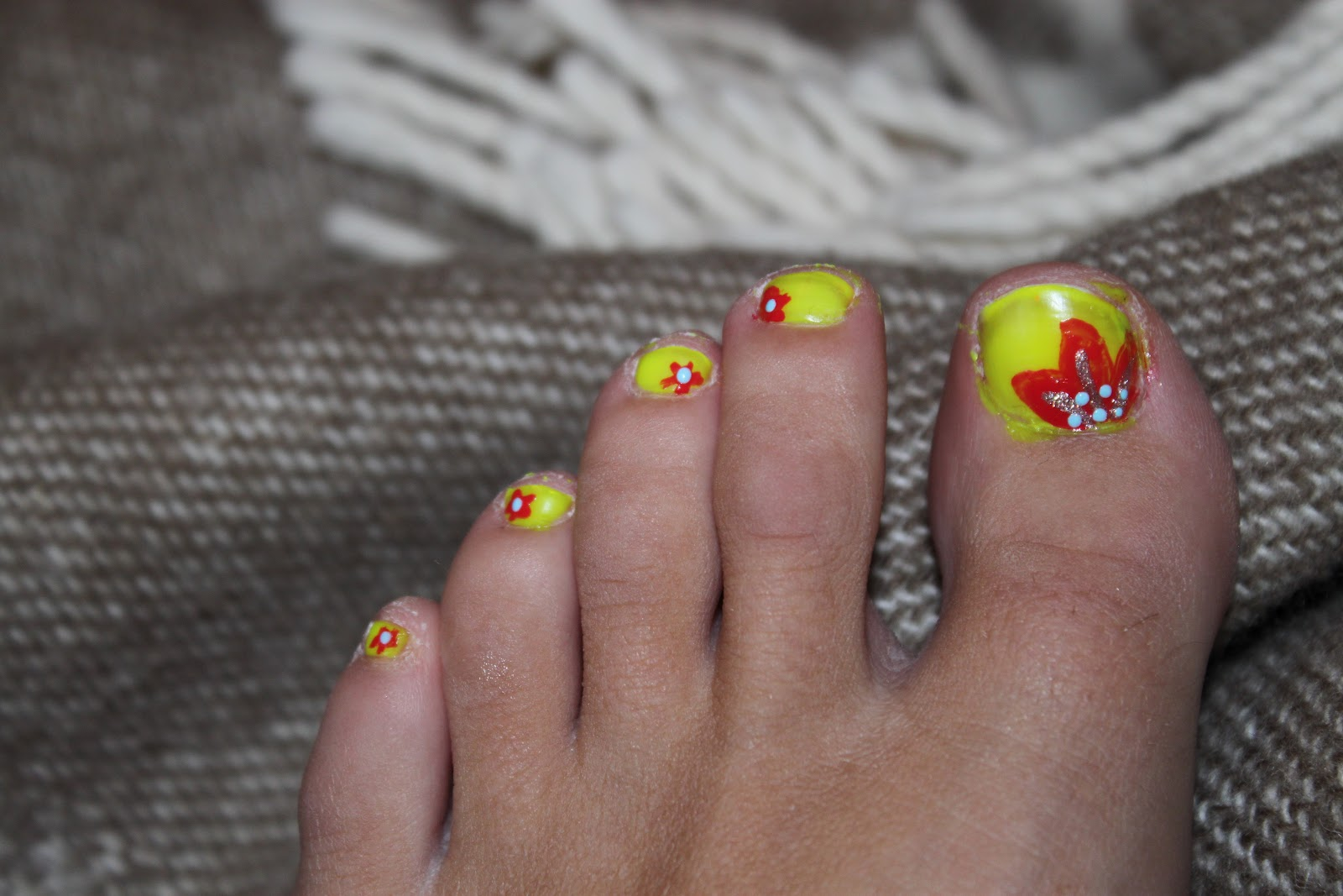 Crazy About Nails: Neon yellow toenails with orange flowers